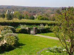 Cottage garden in the summer looking out across the fields
